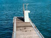 Beach Pier With Elevated Platform For Water Jumping, Sightseeing, Fishing And Snorkeling - Calm Sea  poster