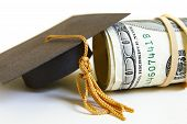 foto of graduation cap  - a graduation cap and cash roll closeup - JPG
