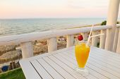 Vacation Drink Orange Juice With Strawberry View Of Sea. Perfect Vacation, Ready To Relax And Chill  poster