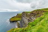Beautiful View Of The Sea And The Limestone Rock Cliffs Along The Coastal Walk Route From Doolin To  poster