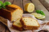 Lemon Pound Cake On Rustic Wooden Background With Lemon poster