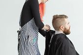 Hairdresser, Stylist And Barber Shop Concept - Woman Hairstylist Cutting A Man poster