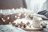 Coffee Cup Over Christmas Lights Bokeh In Home On Wooden Table With Sweater On A Background And Deco poster