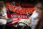 stock photo of ganja  - Dutch Coffeeshop window with people passing outside - JPG