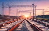 Railroad And Pink Sky With Motion Blur Effect At Sunset. Industrial Landscape With Railway Station,  poster