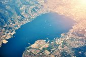 View From Airplane, City In Mountain And Coast poster