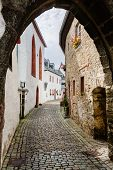 Alley In The Picturesque And Medieval Village Kronenburg In The Eifel Region, Germany poster
