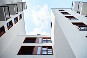 Contemporary Residential Building Exterior In The Daylight. Modern Apartment Buildings On A Sunny Da poster