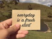 Motivational And Inspirational Wording - Everyday Is A Fresh Start Written On A Paper. Blurred Style poster