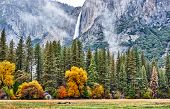 Yosemite National Park Valley with Yosemite Falls at cloudy autumn morning. Low clouds lay in the va poster