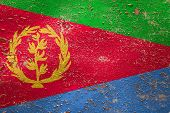 National Flag Of Eritrea  On Old Peeling Wall Background.the Concept Of National Pride And Symbol Of poster