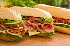 stock photo of deli  - Three fresh sub sandwiches  - JPG