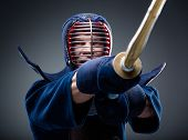 Close up of kendoka training with shinai. Concept of Asian martial arts
