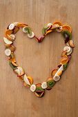 picture of satsuma  - Heart made of sliced fruits with plums - JPG