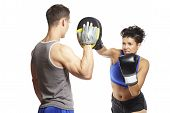 stock photo of sparring  - Young man and woman boxing sparring in sports outfits on white background - JPG