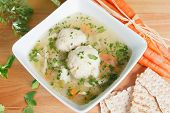 pic of matzah  - Colorful bowl of savory delicious matzah ball kosher soup with carrots - JPG
