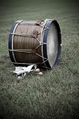 stock photo of 1700s  - Replica of revolutionary war drum sitting in a field - JPG
