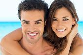 Closeup Portrait Of Happy Beautiful Couple Hugging On Beach