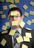 Businessman With Reminder Notes