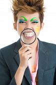 stock photo of freaky  - Smiling freaky asian freak with a magnifier - JPG