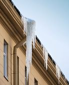 Danger Big Icicle Hanging On Drainpipe poster