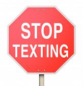 A red octogon shapped sign reading Stop Texting to illustrate the danger of text messaging while in