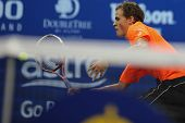 KUALA LUMPUR - SEPTEMBER 24: Vasek Pospisil (Canada) plays a volley at the net in a first round tenn
