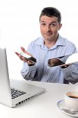Businessman Overwhelmed With Technology