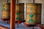 Buddhist prayer wheels in Diskit gompa (Tibetan buddhist monstery). Nubra valley, Ladakh, India