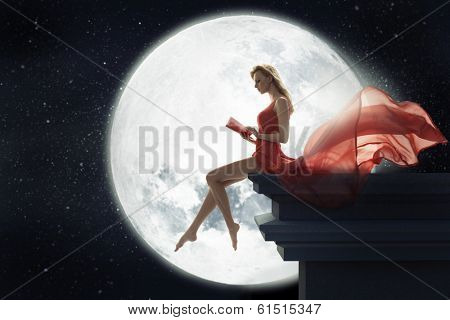 Cute woman over full moon background poster