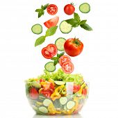 image of edible  - Fresh mixed vegetables falling into bowl of salad isolated on white - JPG