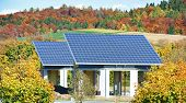stock photo of accumulative  - Solar panels buildings for sun energy accumulation in the field - JPG