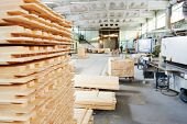 Stacked wood pine timber production for processing and furniture production at woodworking enterpris