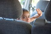 picture of seatbelt  - Kid children girl happy greeting gesture hand in car vehicle indoor - JPG