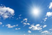 picture of cumulus-clouds  - Blue sky with fluffy clouds and sun - JPG