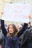 MOSCOW - MARCH 15: Young woman with the poster in a time of a protest manifestation against war in U