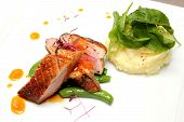 image of duck breast  - A Duck breast with orange sauce and mash totato - JPG