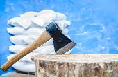 stock photo of ax  - an old ax stuck in a wooden deck - JPG