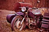 picture of sidecar  - Old motorcycle with sidecar abandoned into a country yard