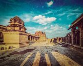 foto of krishna  - Vintage retro hipster style travel image of Krishna temple on sunset with grunge texture overlaid - JPG