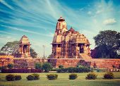 foto of mahadev  - Vintage retro hipster style travel image of Khajuraho Devi Jagdamba temple and mahadev mandapa on sunrise - JPG