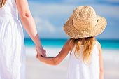 image of daughter  - Back view of mother and daughter at Caribbean beach - JPG