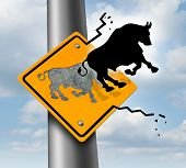 pic of prosperity sign  - Bull market rise business and finance concept for wealth growth as a yellow traffic sign with a bull icon breaking out of the metal and escaping to higher levels of economic success and profitability - JPG