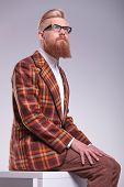 foto of long beard  - relaxed male model with long beard and glasses looking up to his side - JPG
