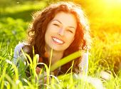 stock photo of pollen  - Beautiful Spring Young Woman Outdoors Enjoying Nature - JPG