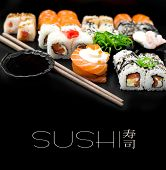 stock photo of dragon-fish  - Sushi set isolaterd  on black background - JPG