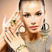 stock photo of minx  - Portrait of the beautiful fashion woman with black makeup and golden manicure - JPG