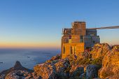 stock photo of fynbos  - Cable Car Station At Top of Table Mountain with Lion - JPG