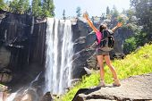 stock photo of nationalism  - Hiking woman freedom in Yosemite national park by waterfall - JPG
