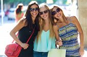stock photo of overspending  - Outdoor portrait of group of beautiful young girls in the street. Shopping day.